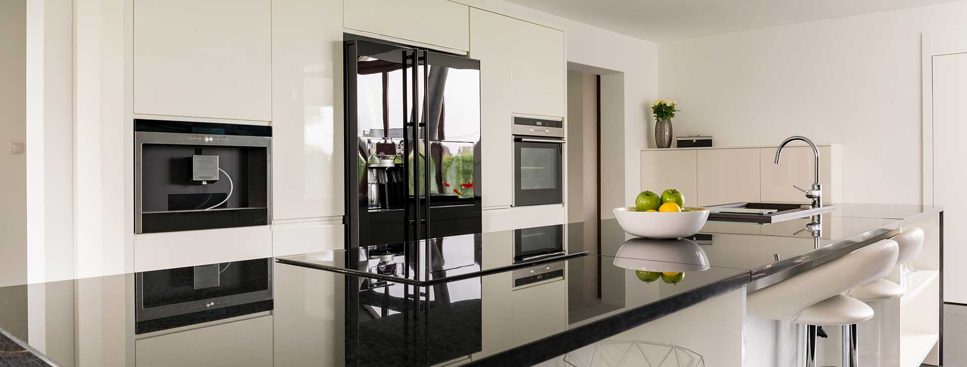 Sleek black stone benchtop in a modern kitchen