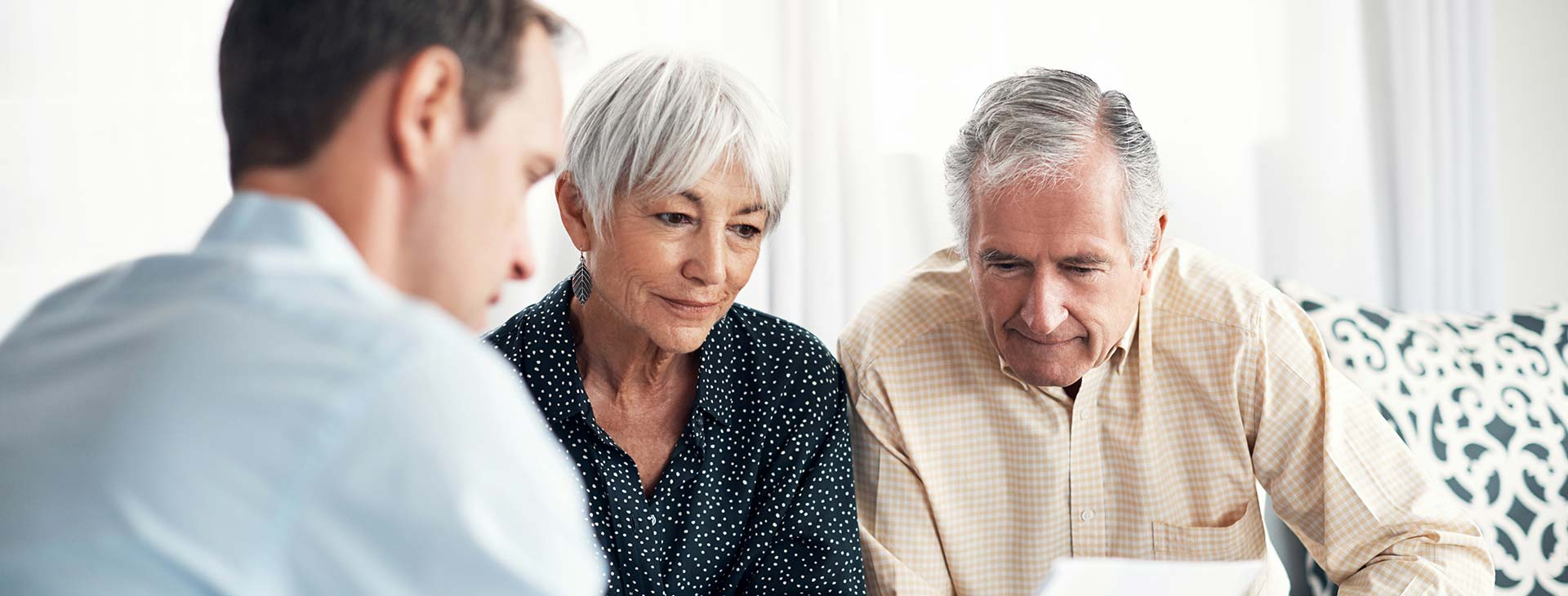 Mature couple discussing options with reputable kitchen company designer