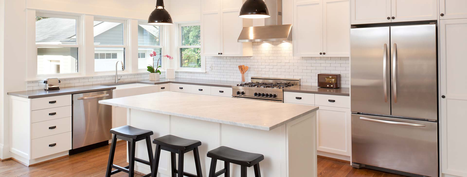 Stainless steel black and white themed renovated kitchen