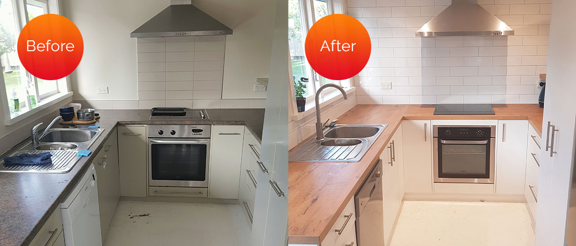 Outdated, beige doors & drawers and laminate benchtop, updated to a bright, white & wood kitchen, with a full-wall, white, tiled backsplash.