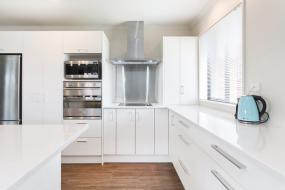White Kitchen and Benchtop with Stainless Steel appliances